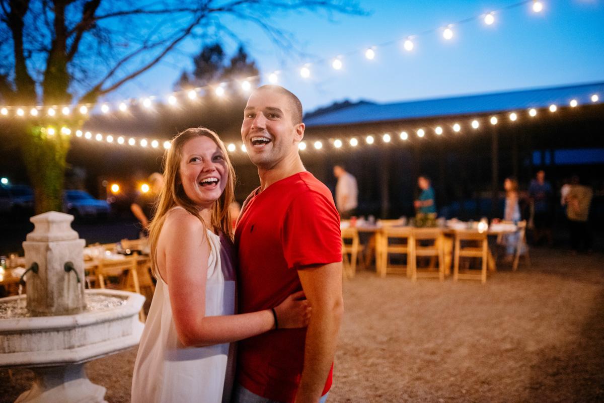 bride groom dancing under string lights jq dickinson saltworks wedding reception