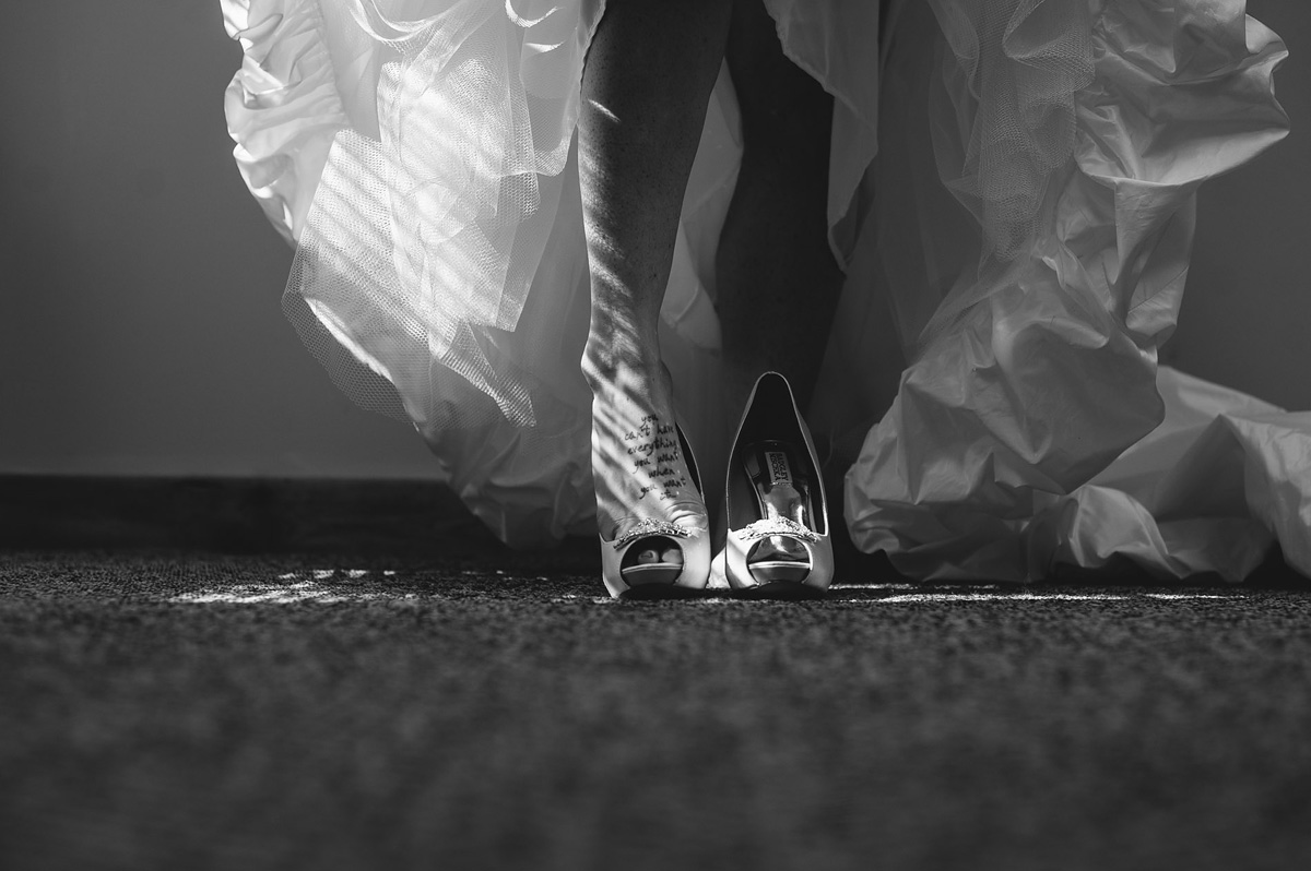 adventuresonthegorge wedding bride putting shoes on