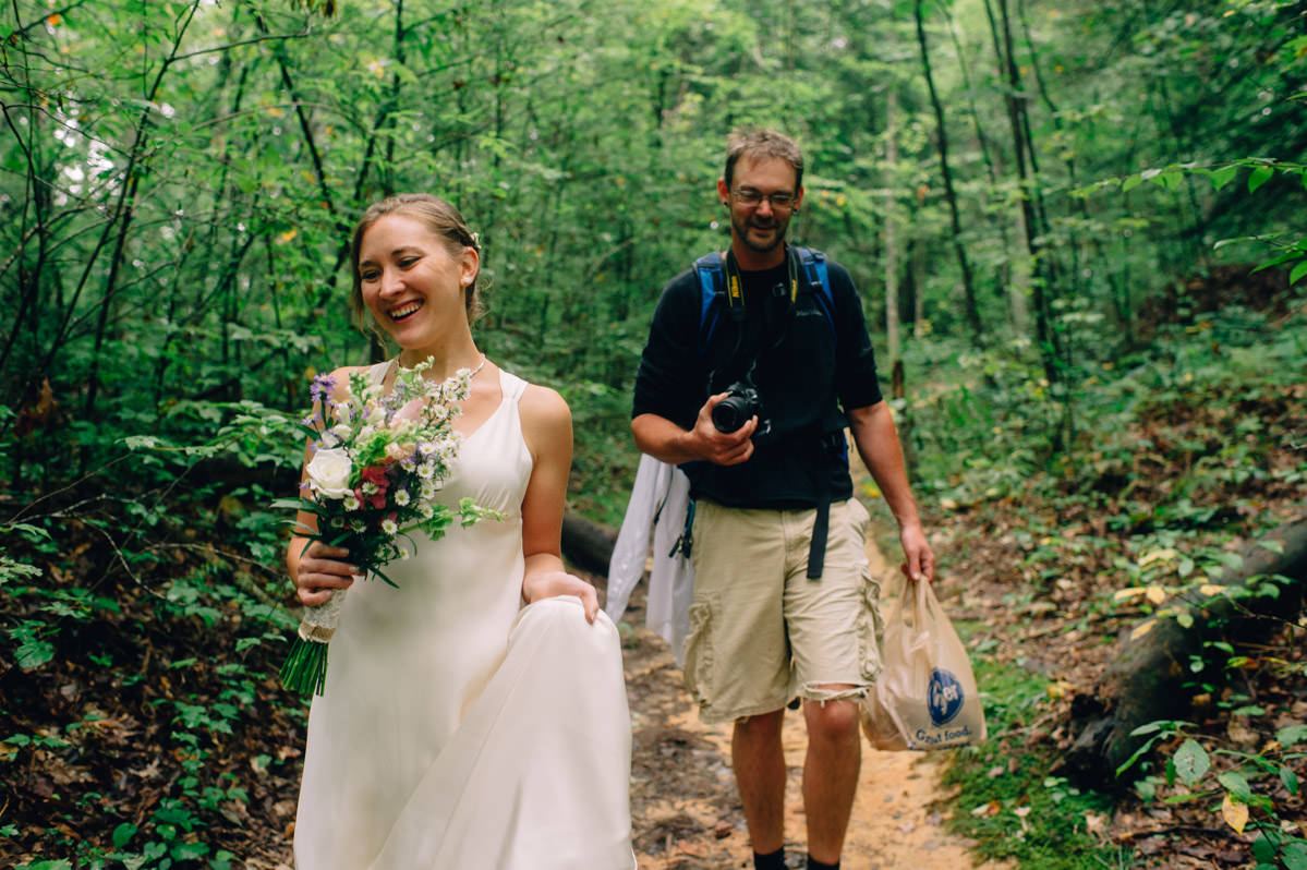 bride groom hiking on wedding day