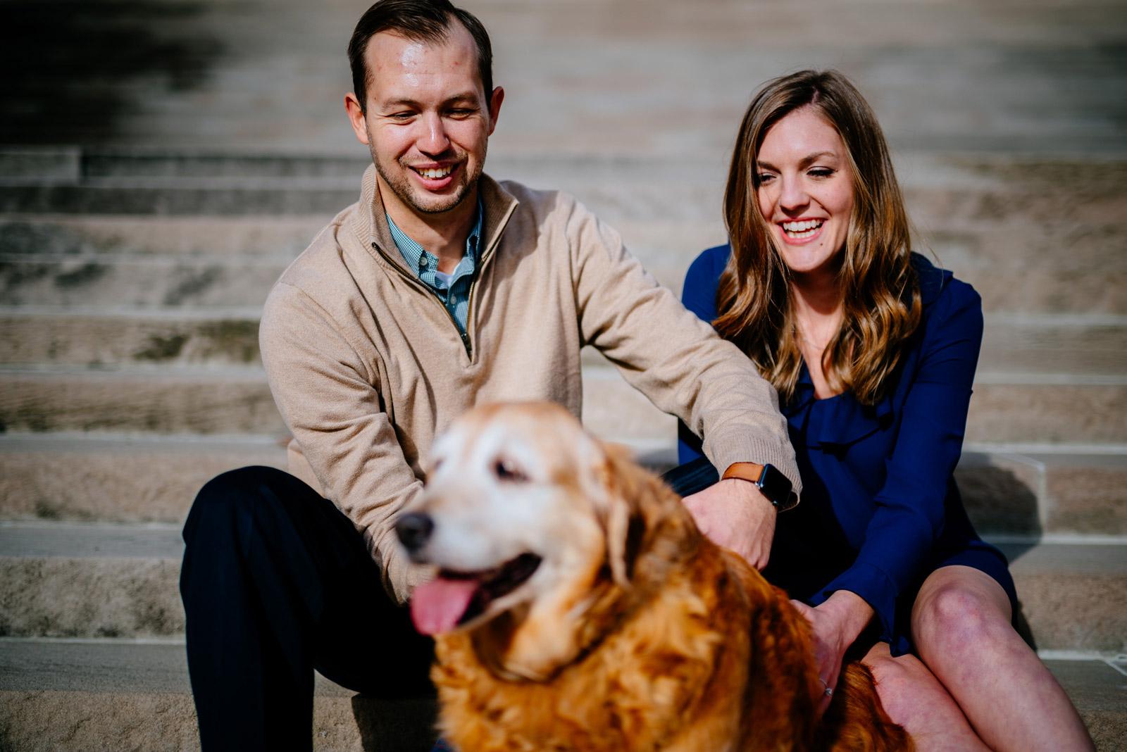couple petting dog charleston wv capitol building