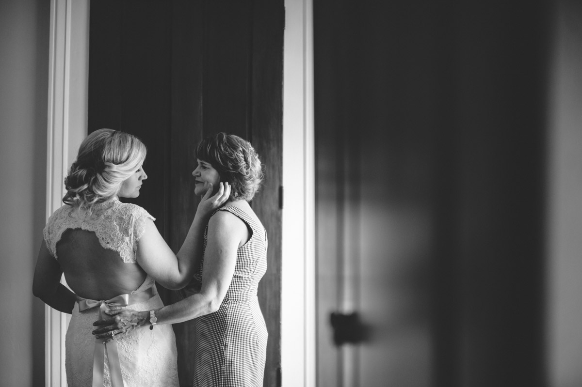 tender moment between mother and her daughter on wedding day
