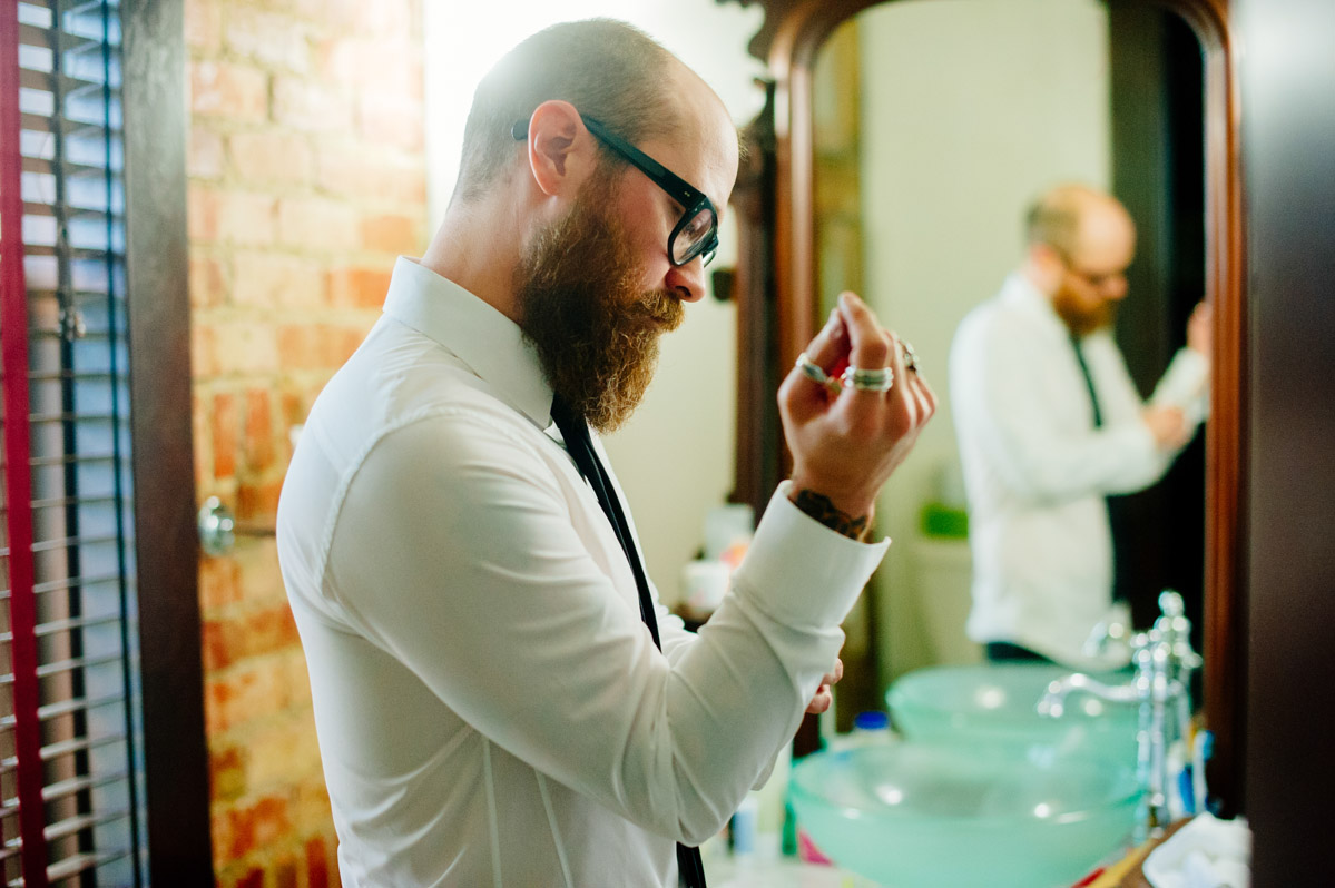 bearded groom getting dressed designer rings fashion inspiration