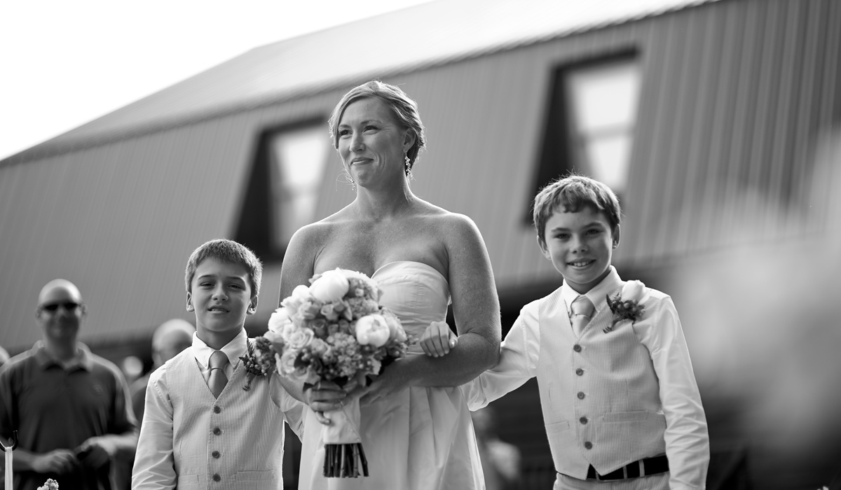 bride walking down aisle with her sons