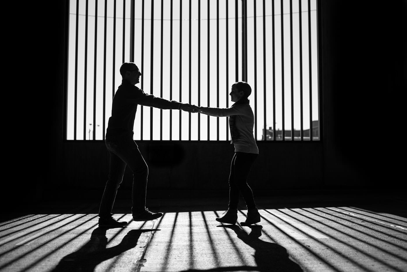 dancing in the shadows creative black and white engagement portrait