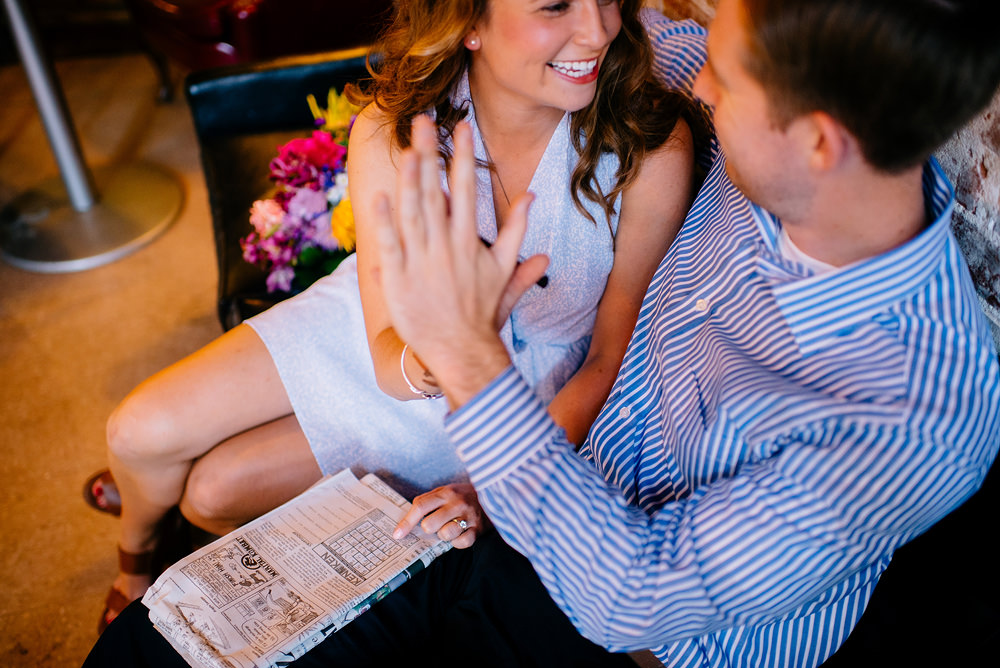 engagement session crossword puzzles at coffee shop