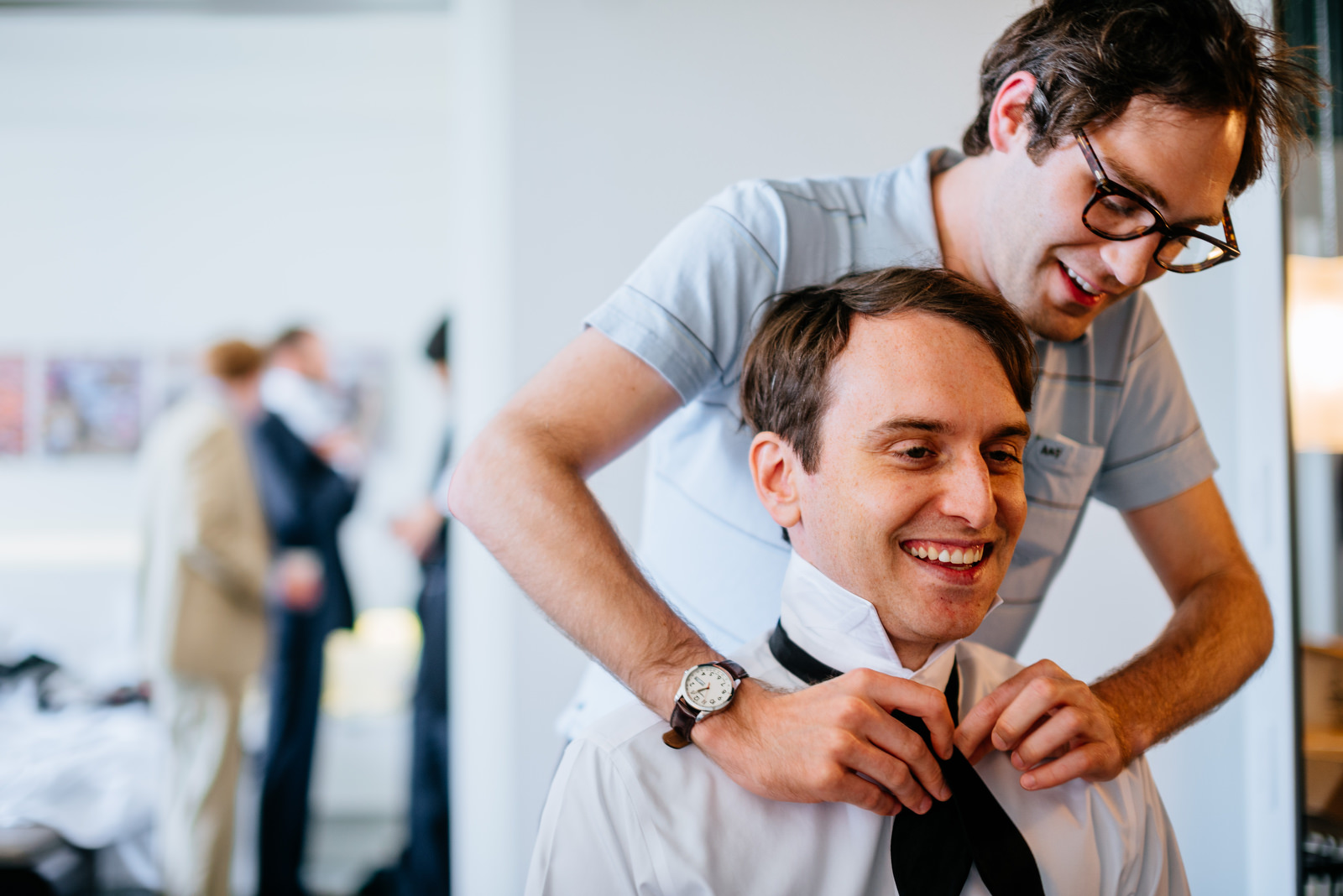 groom putting on tie wedding 21c hotel lexington ky