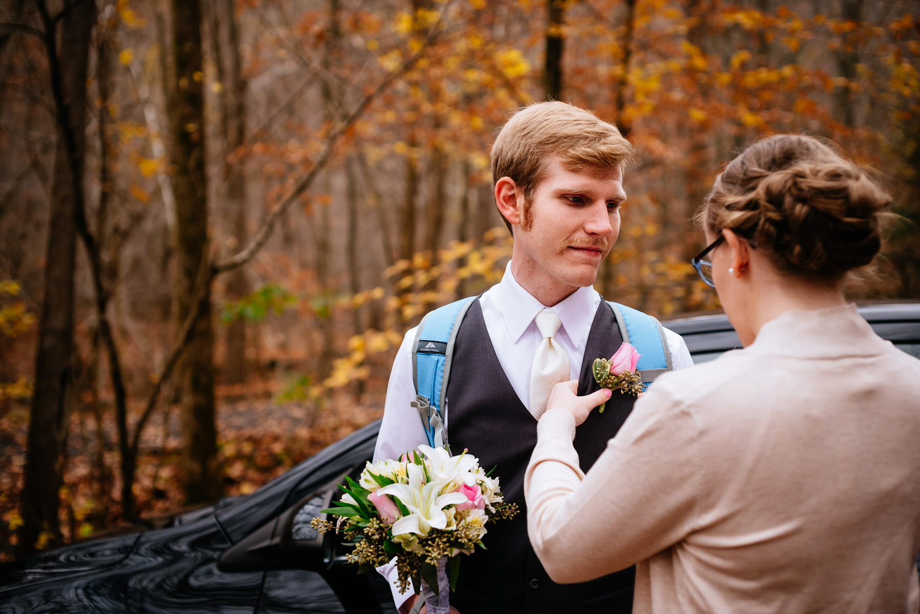 wv hiking elopement groom getting boutonniere