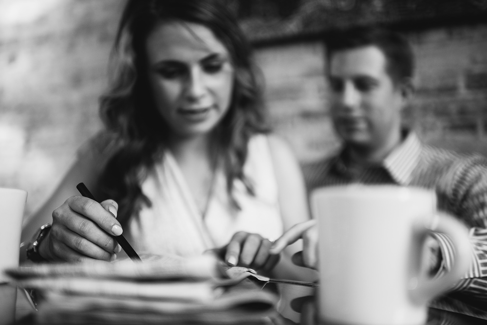 engagement session crossword puzzles at coffeeshop