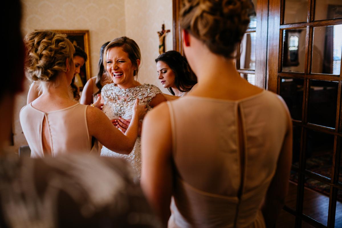 wv winter wedding bride getting dressed