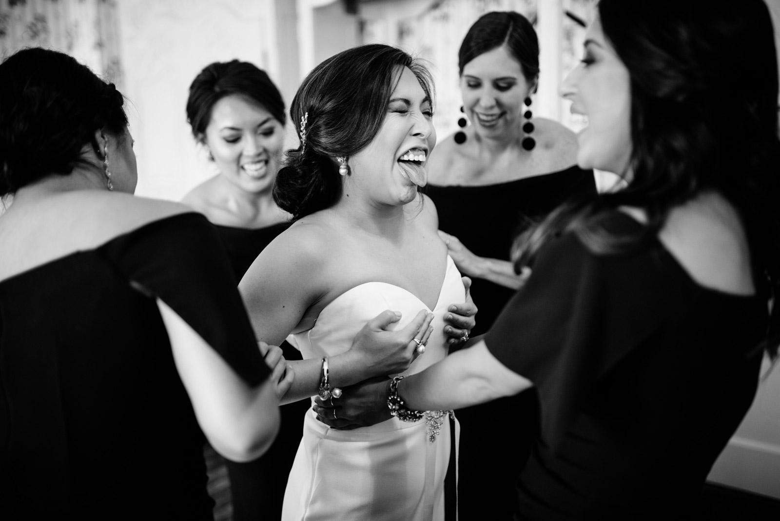 bride getting dressed greenbrier chapel wedding