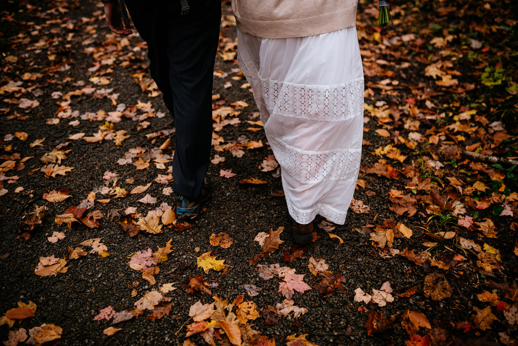 bride groom walking through leaves wv hiking elopement