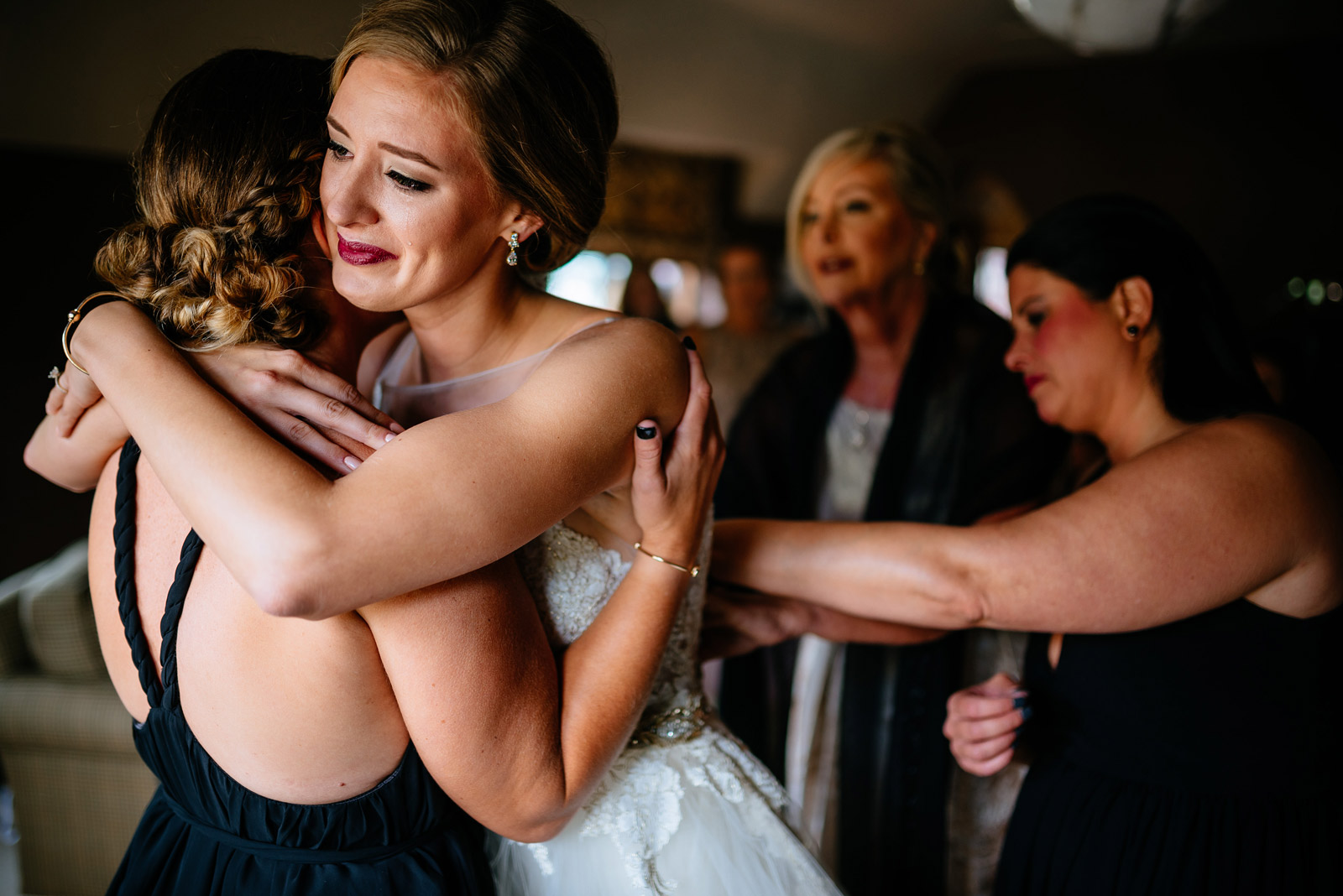 bride hugging bridesmaid zenner house wedding