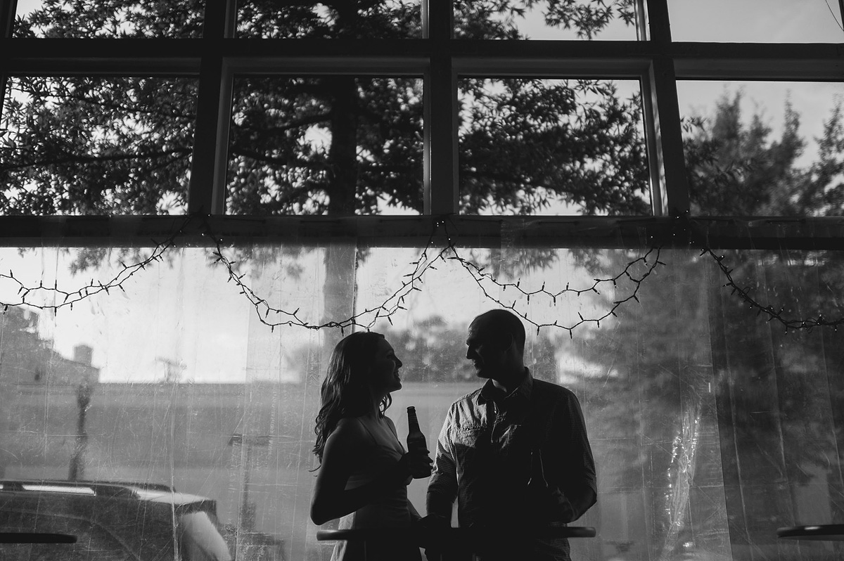 couple drinking beer dc arligton clarendon black and white engagement photo
