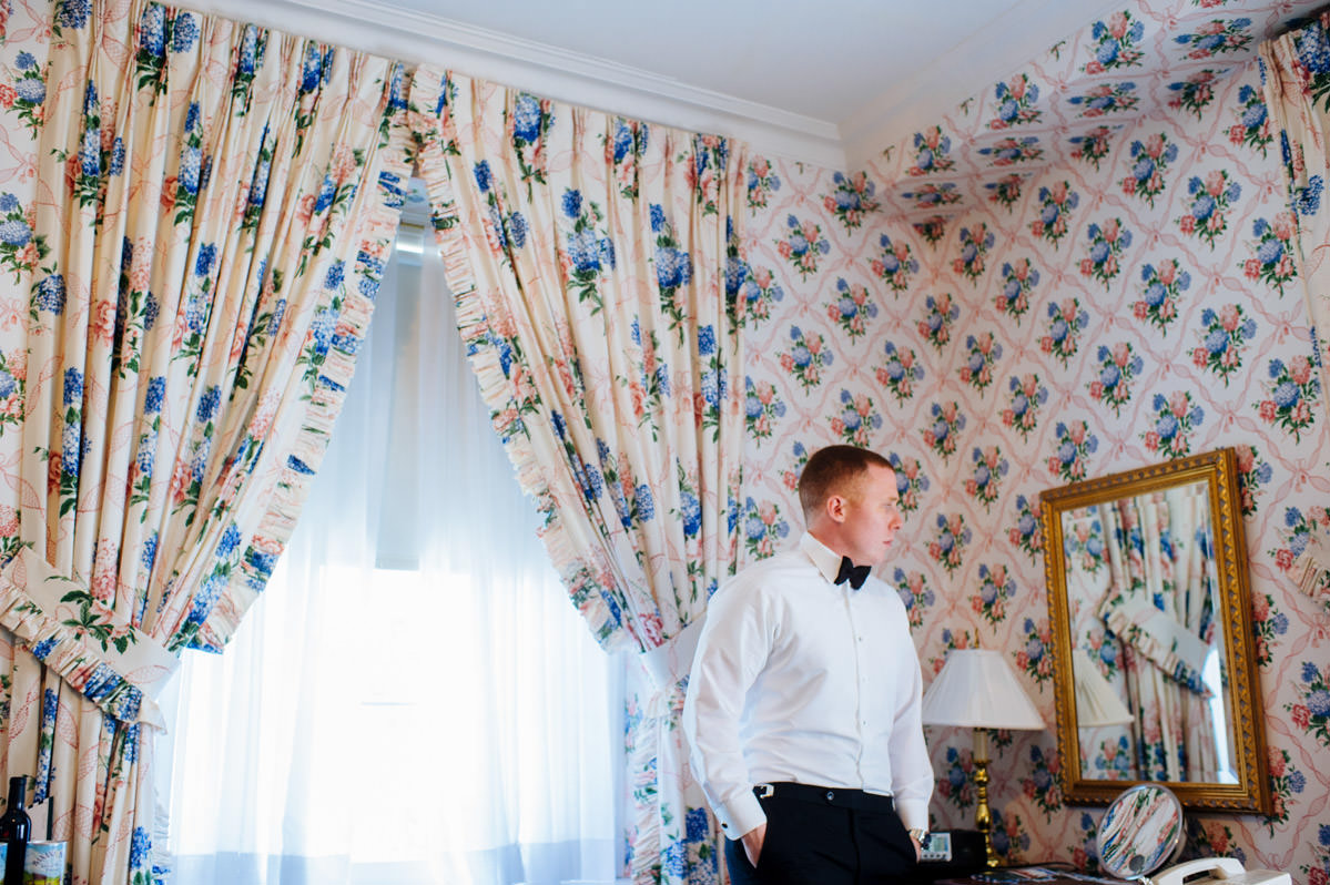 groom getting dressed classy greenbrier resort wedding by best wv photographers the oberports