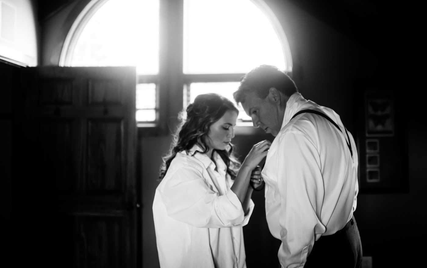 bride helping dad with suspenders
