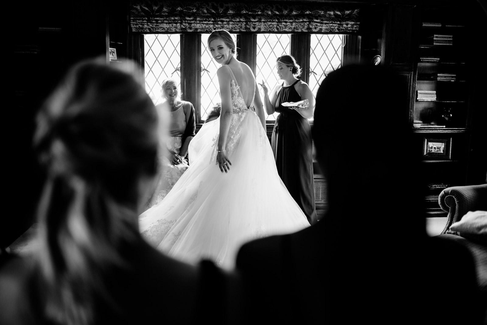 bride shows off dress to bridesmaids zenner house wedding athens ohio