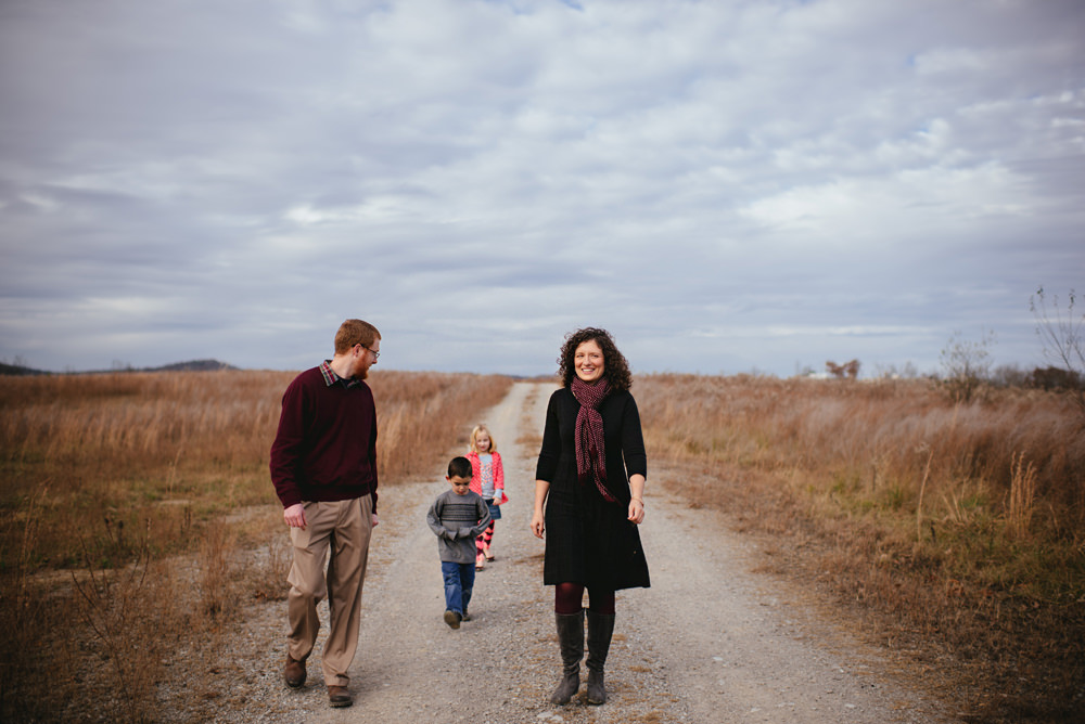 family walking on country road in west virginia