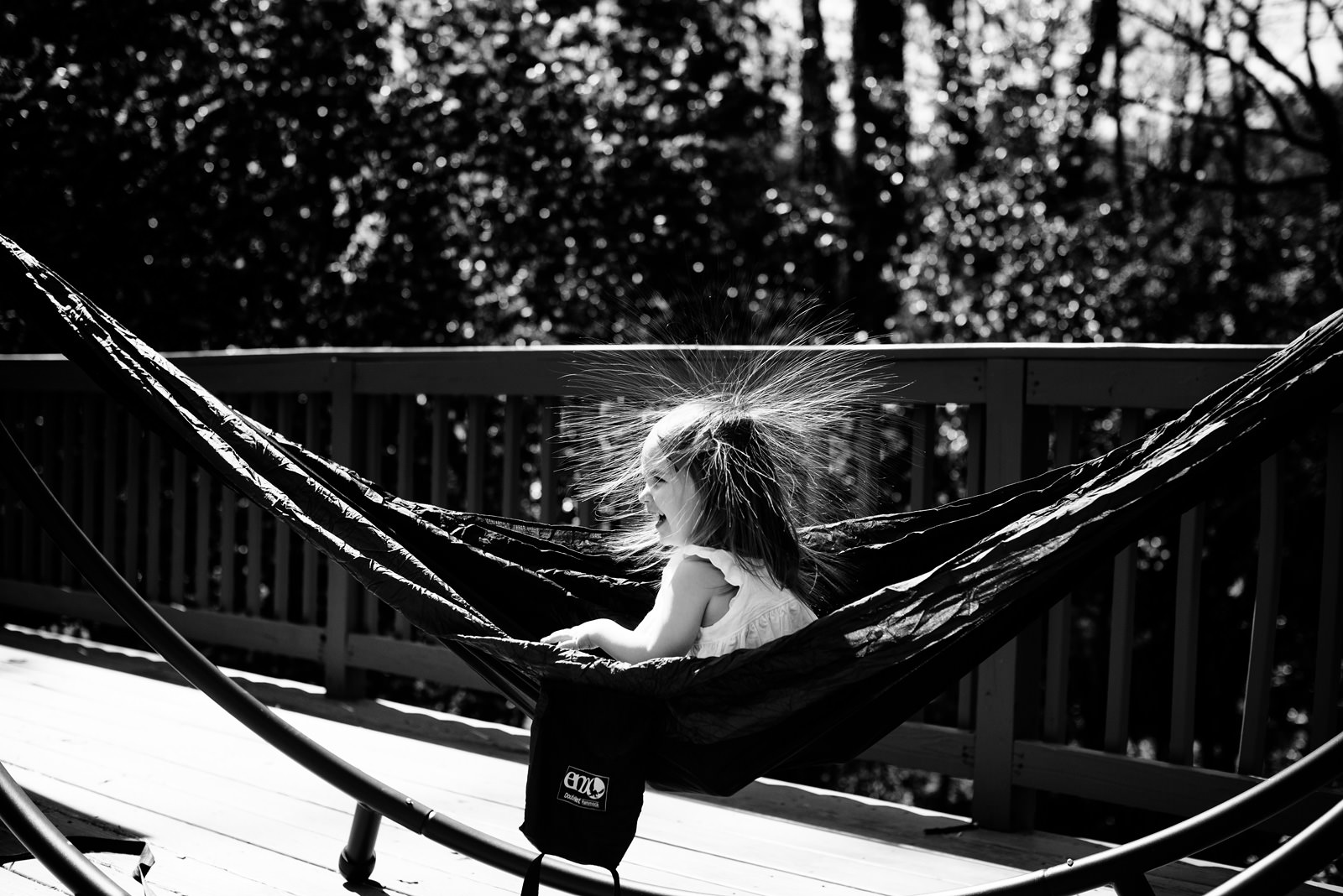 kid in hammock with static hair