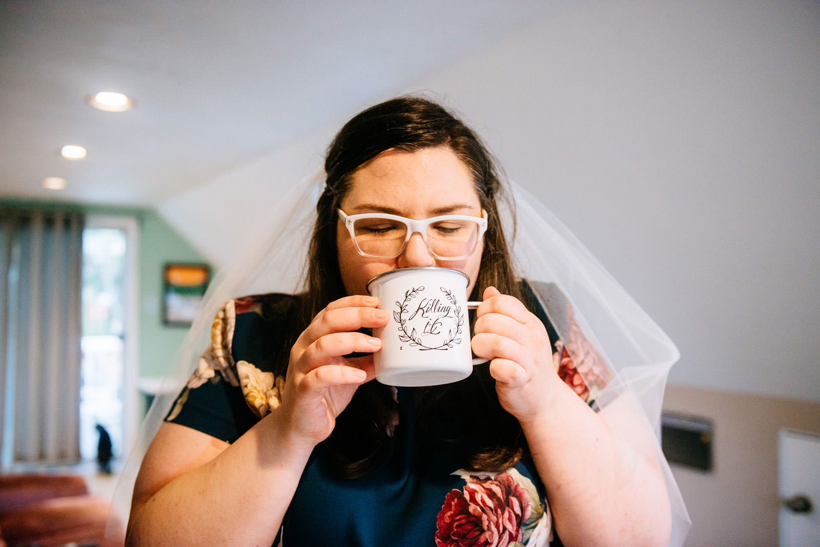 bride drinks coffee from killing it cup