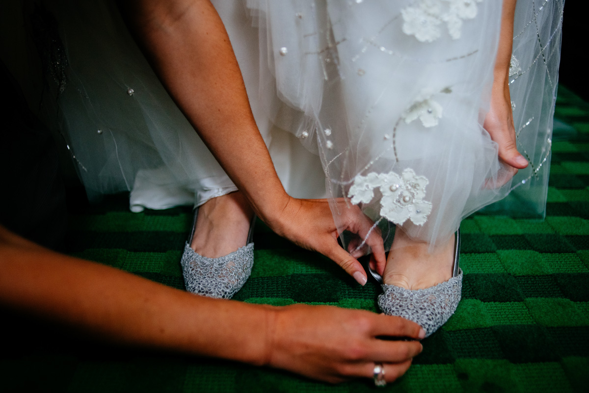 bride getting into shoes at the greenbrier resort