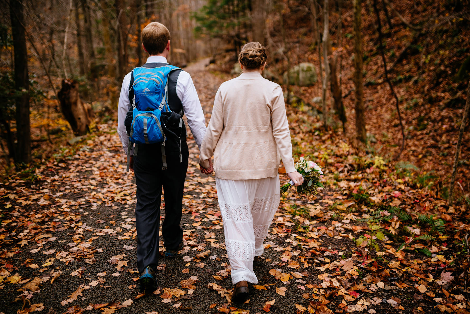 bride groom walking through forest wv hiking elopement