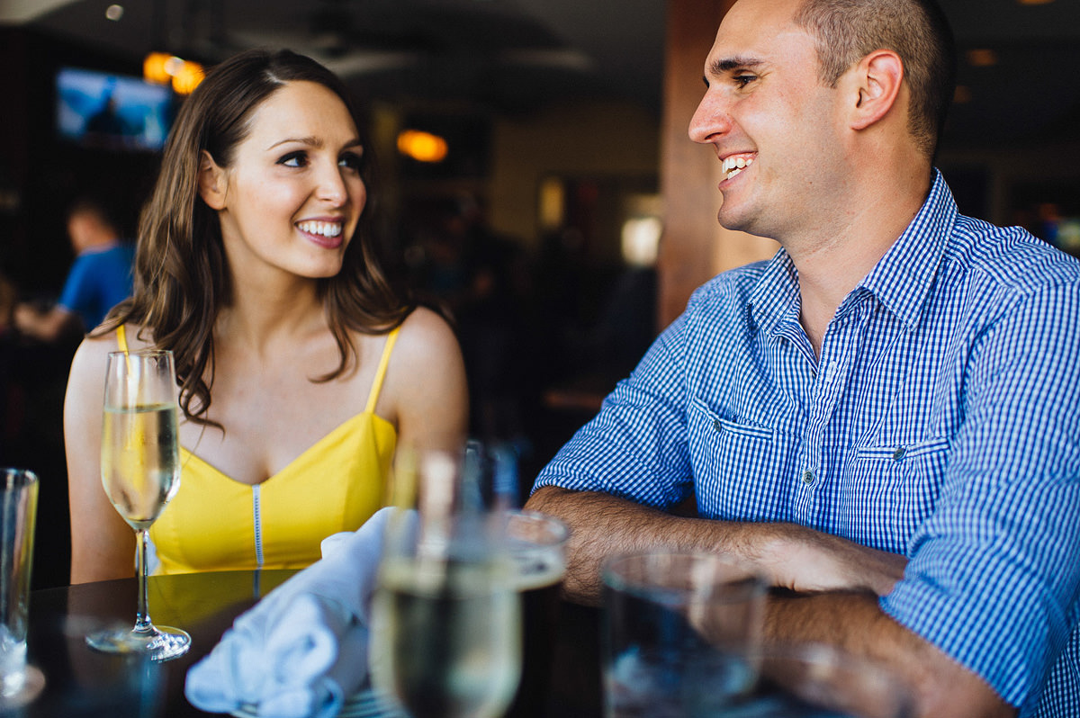 candid engagement photo in restaurant by the oberports