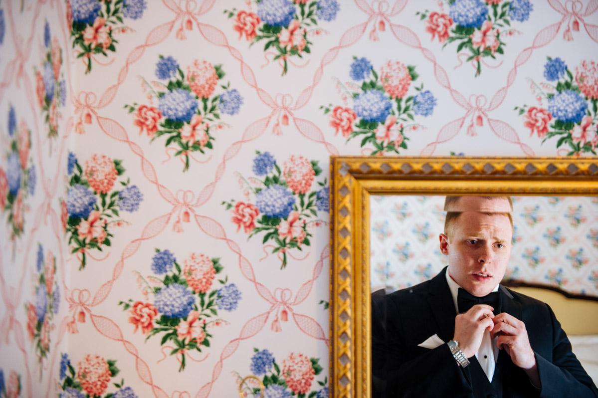 dorothy draper wallpaper greenbrier groom putting on bowtie
