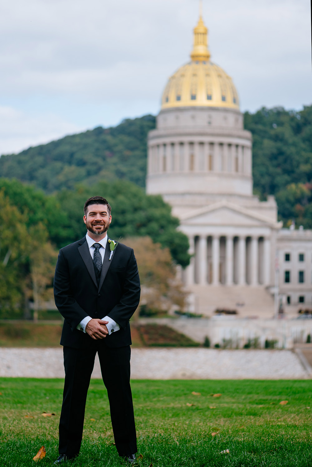 groom on the UC lawn with WV capitol in background