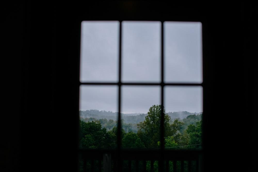 rain and fog on the mountaintop through window west virginia