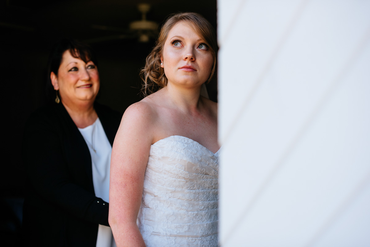 bride getting dressed with mother craik patton house charleston wv