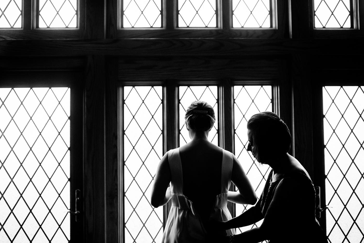 bride getting ready in front of cool window