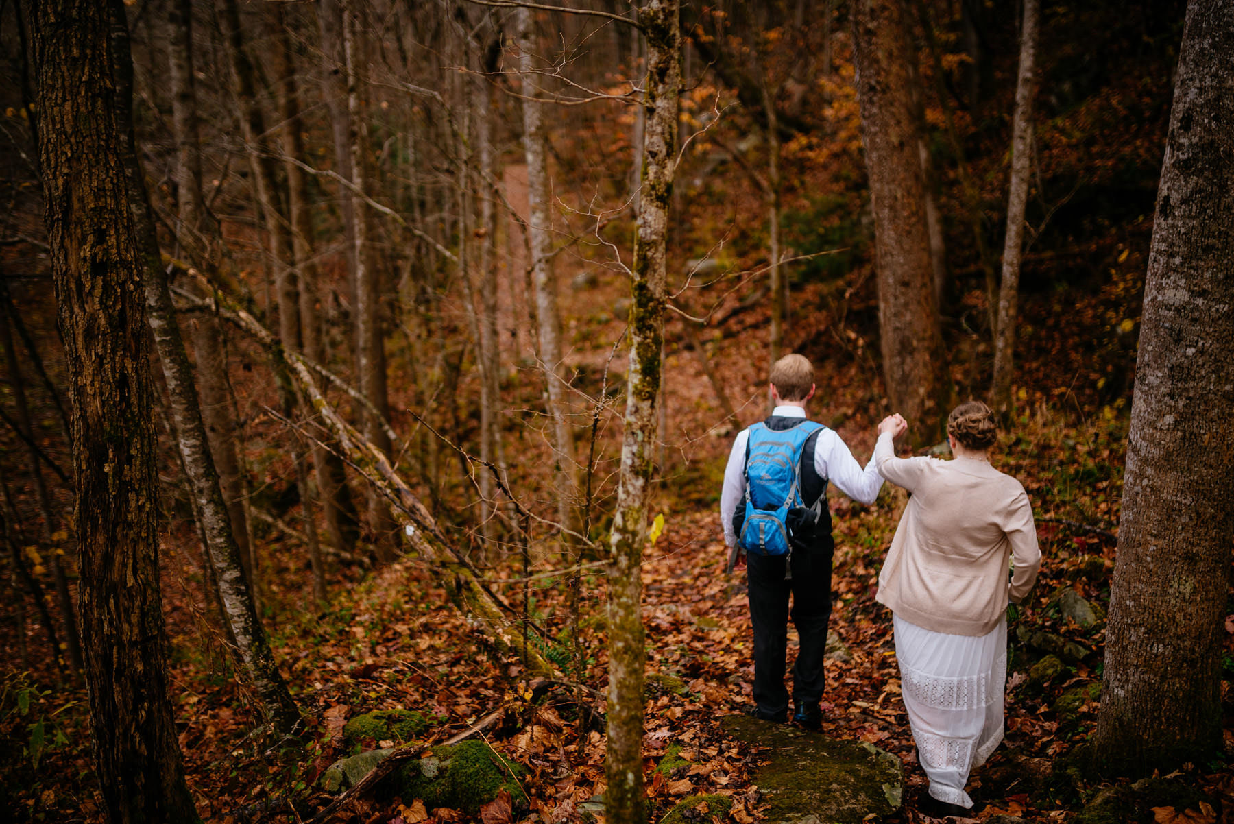 bride groom walking through glade creek wv hiking elopement