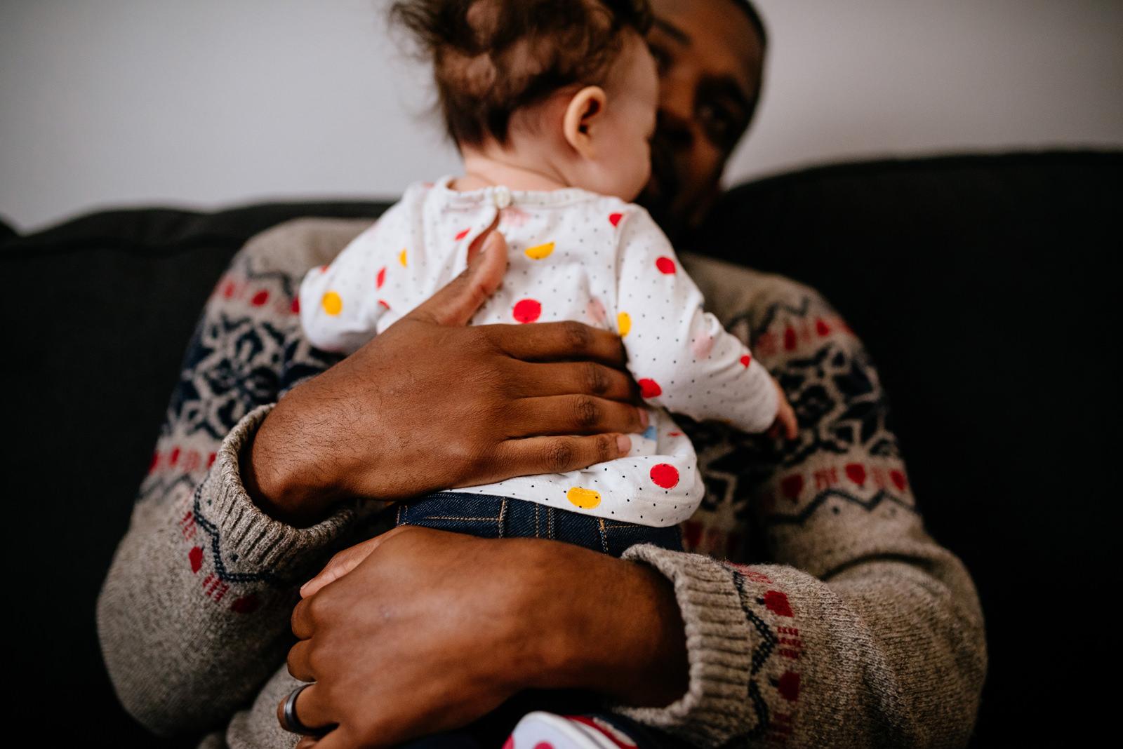 dad hugging baby daughter