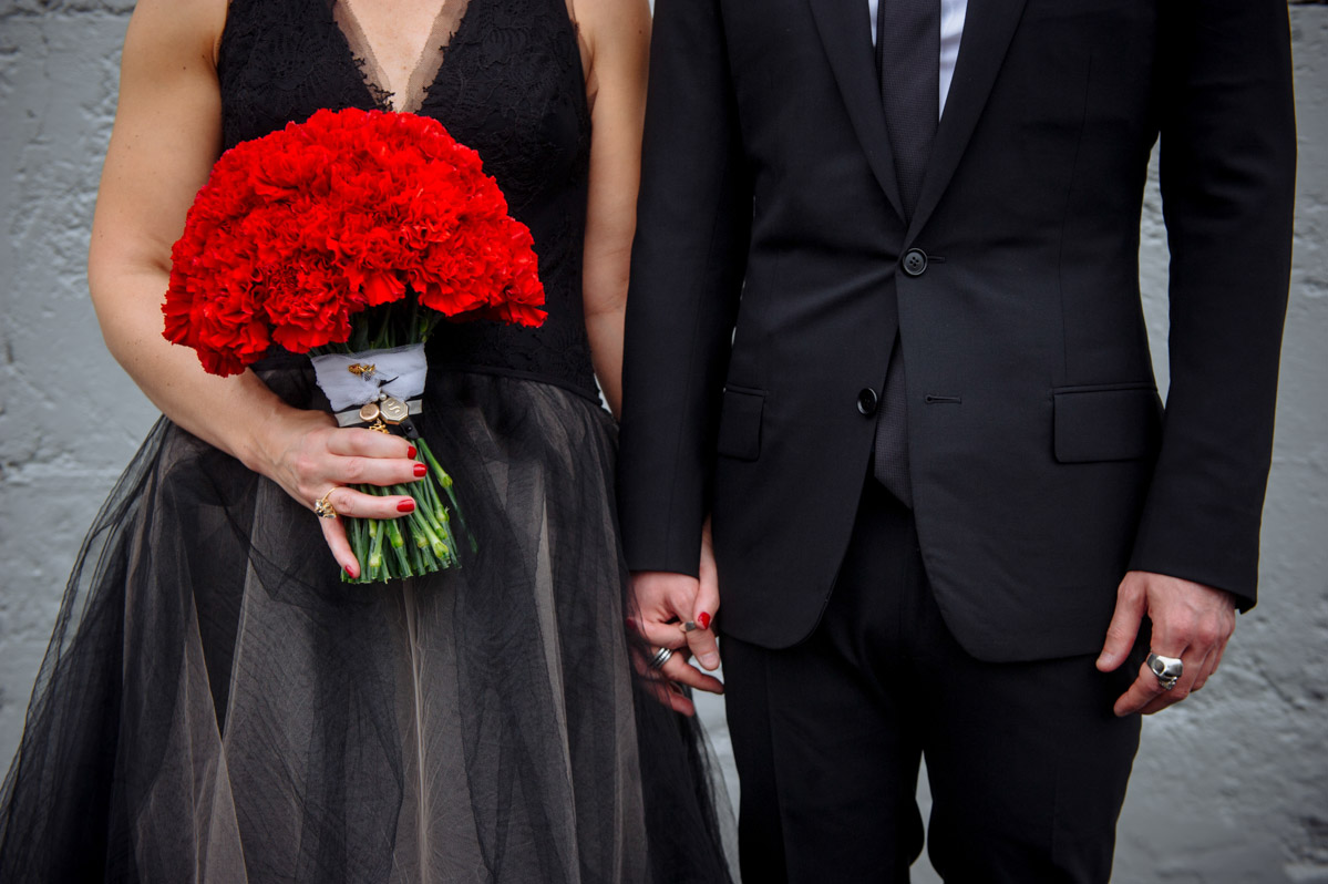 wedding details vera wang black dress dior homme suit red carnations bouquet