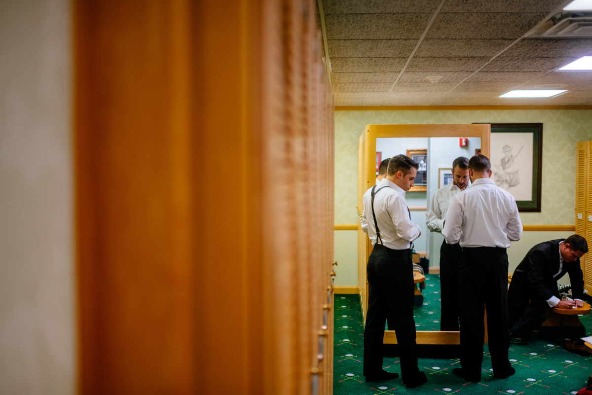 groomsmen getting ready at greenbrier sporting club