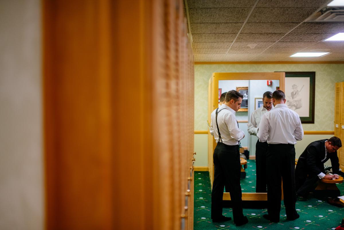 groomsmen getting ready at greenbrier sporting club
