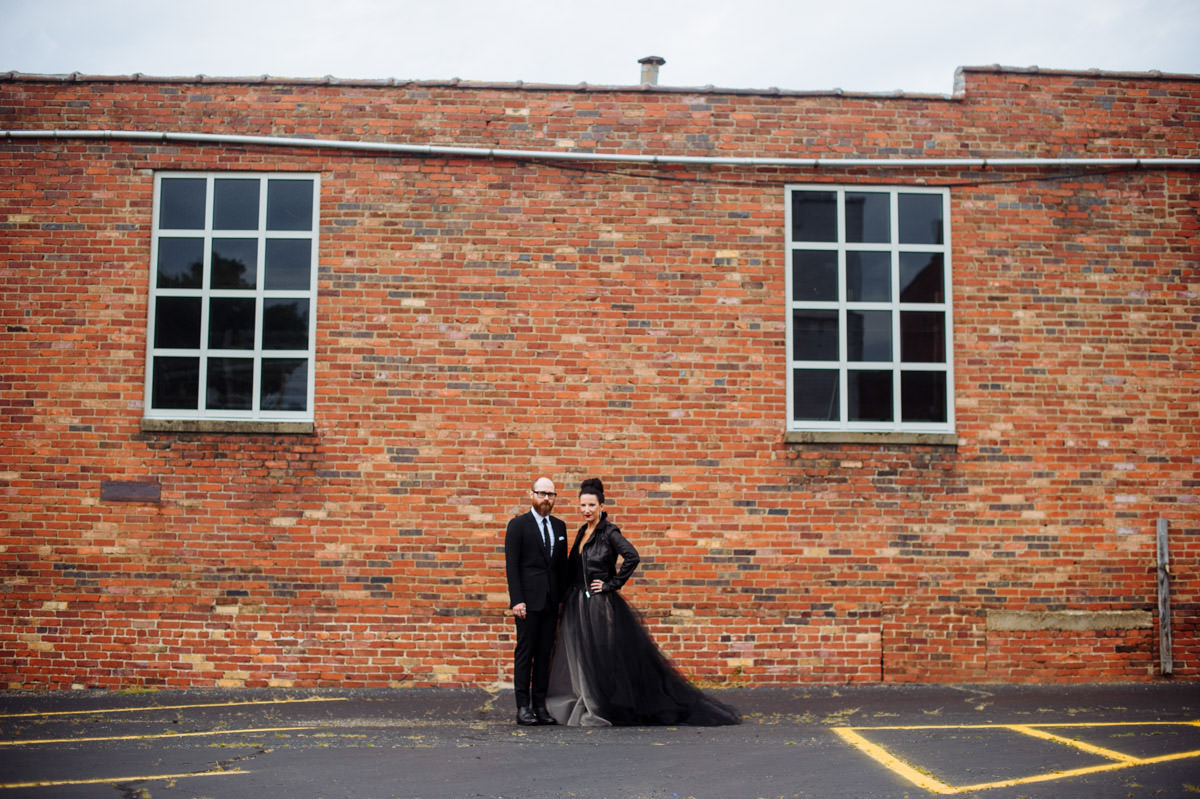 bride and groom portrait with rick owens stooges jacket by best wv wedding photographers the oberports