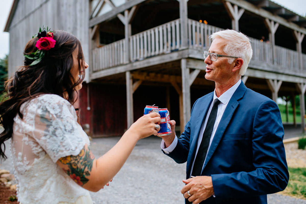 bride and groom rustic acres beer