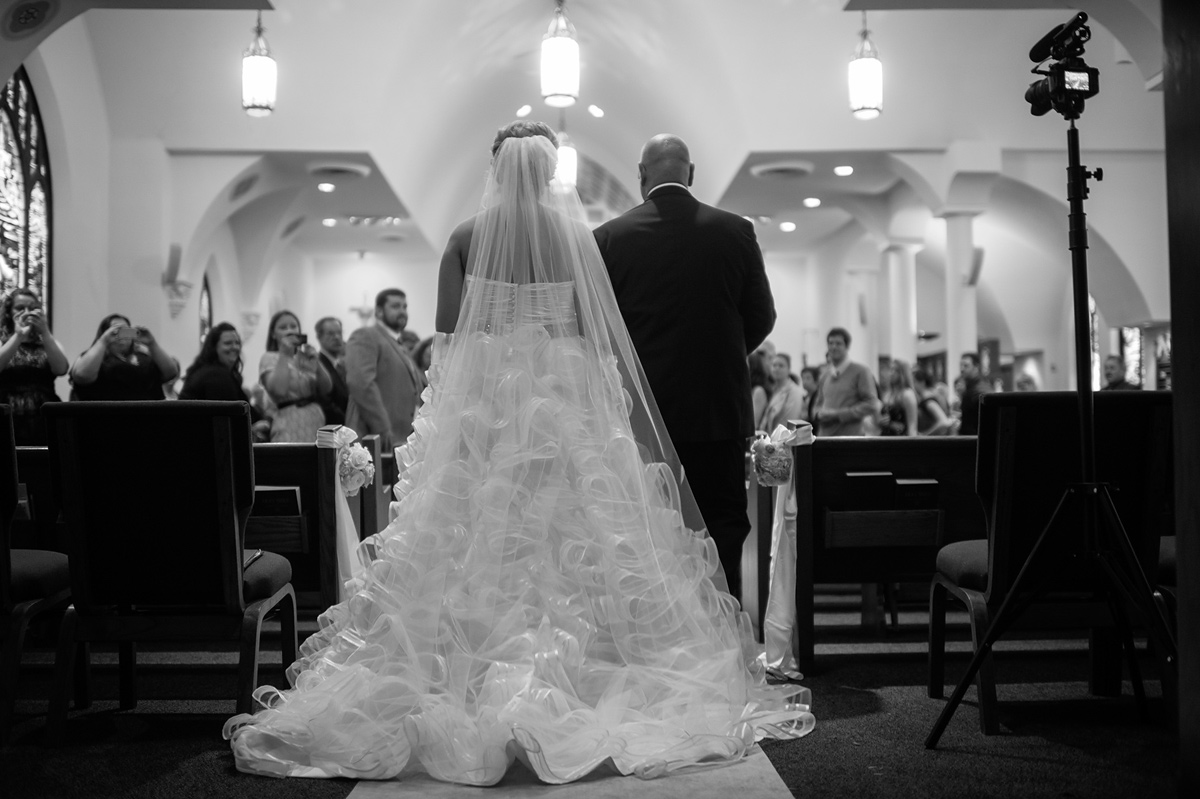 bride walking down the aisle from behind