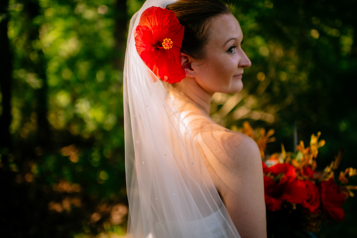 bride with hibiscus in her hair