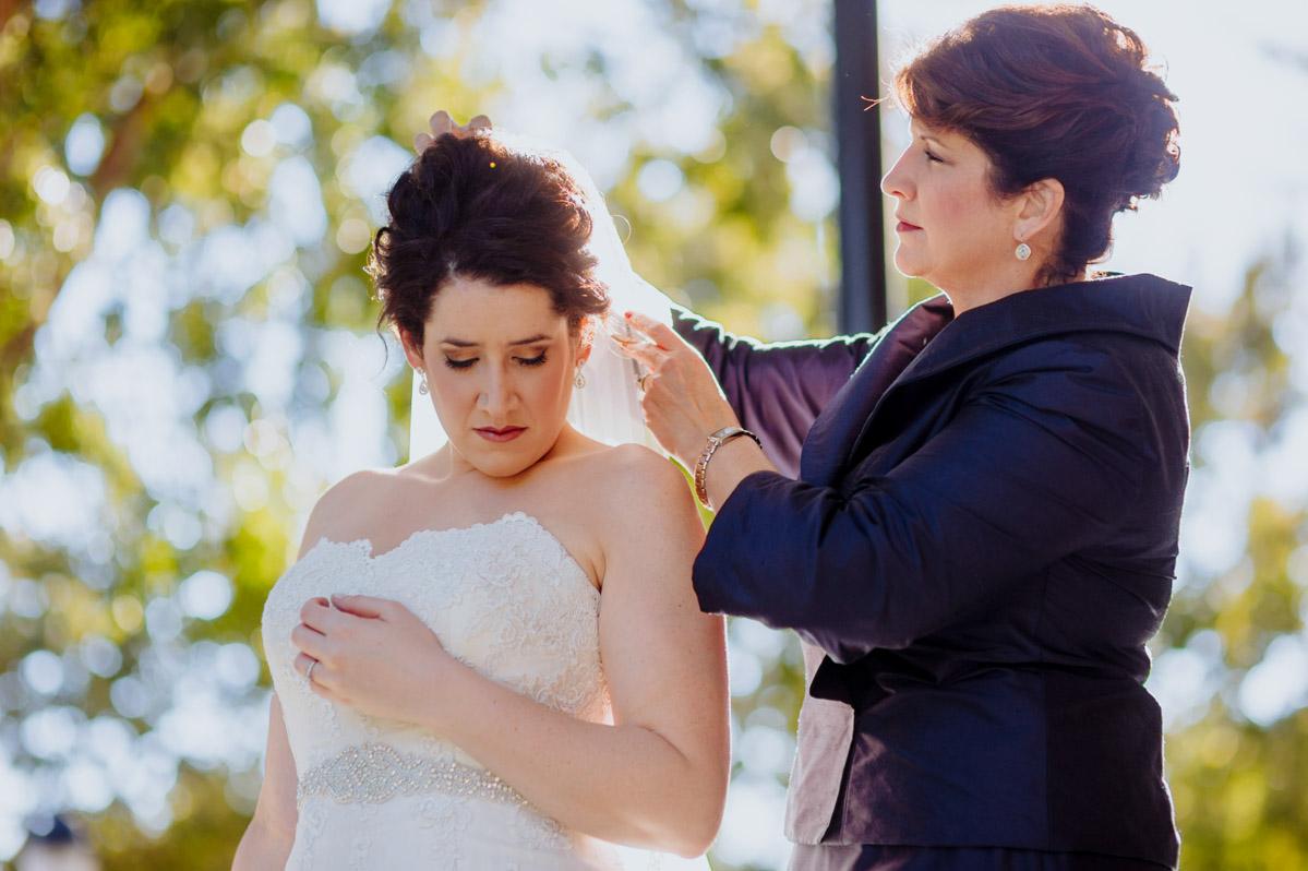 mom helps bride with veil