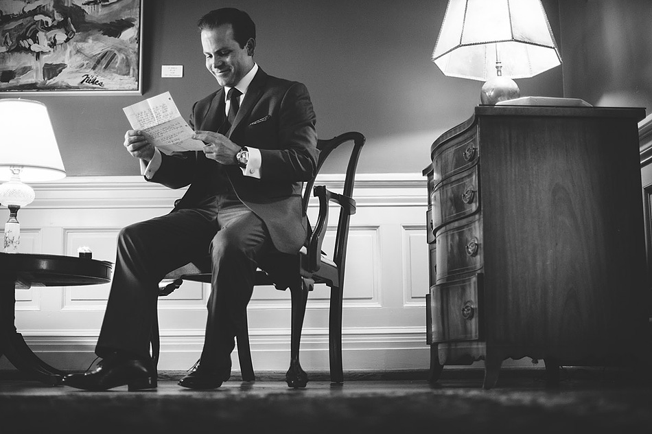 black and white wedding groom opening gift