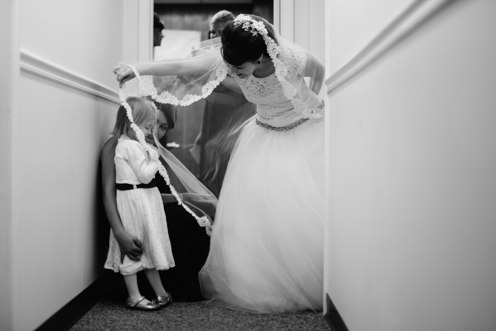 bride and flower girl wedding photojournalism by the oberports