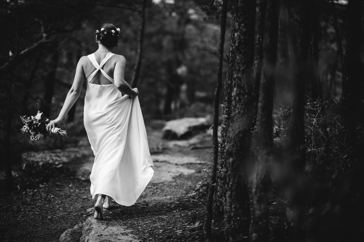 bride walking barefoot on long point trail by best west virginia wedding photographers the oberports