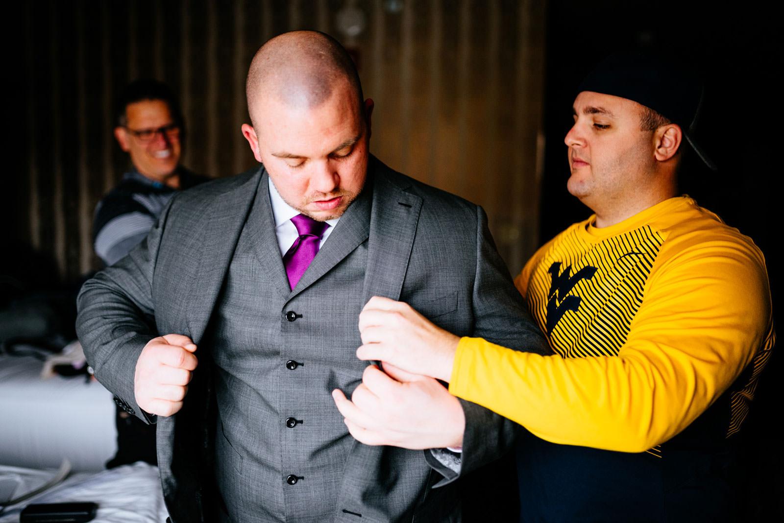 groom getting dressed morgantown wv wedding