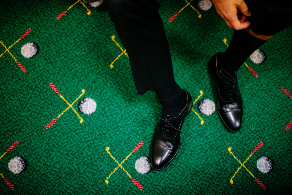 groom putting shoes on at the greenbrier sporting club