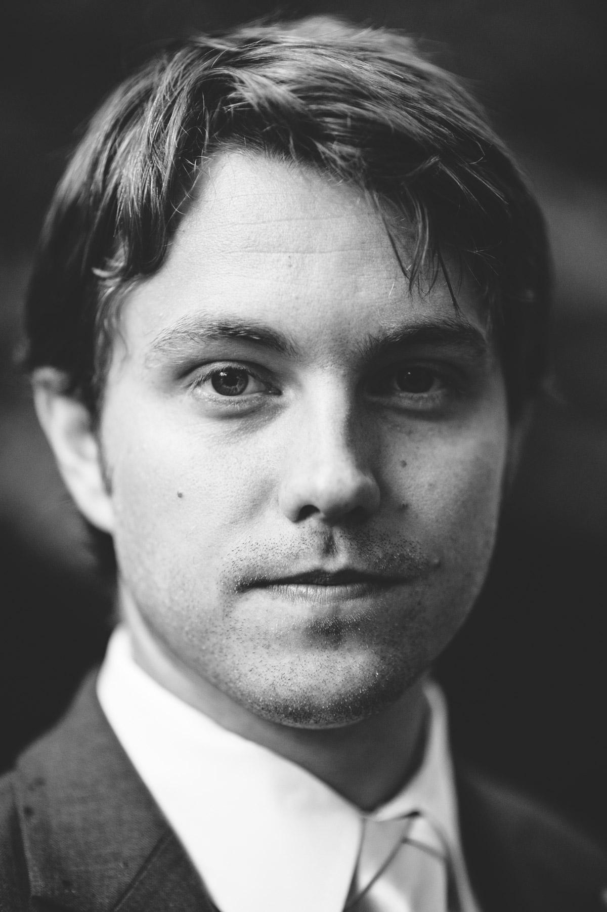 black and white groom closeup