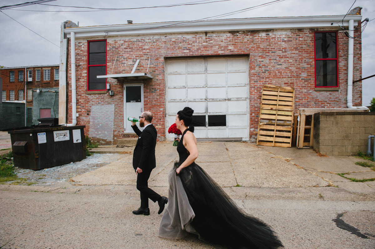 bride and groom walking through alley in marietta ohio
