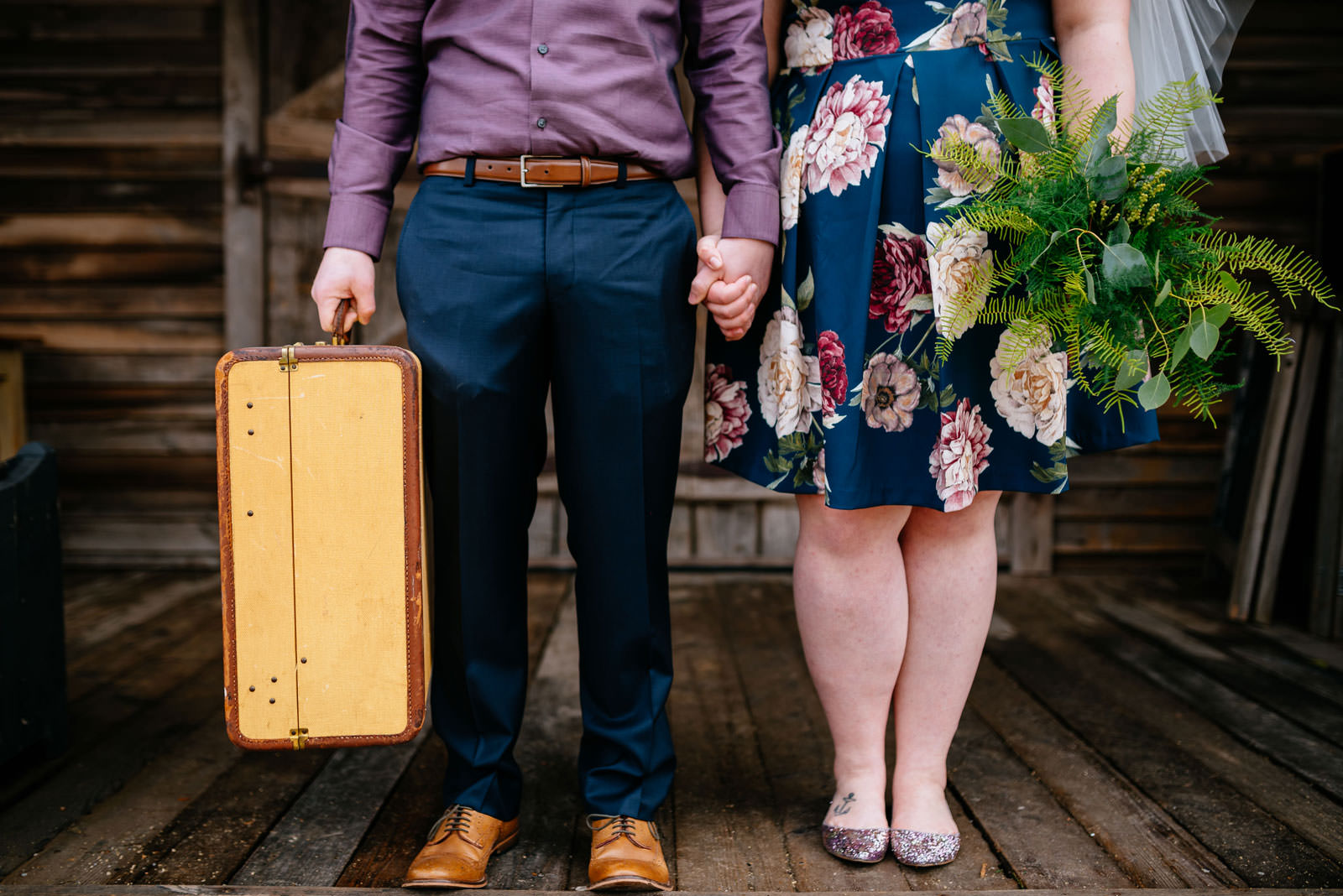 bride and groom with bouquet and suitcase terrain elopement