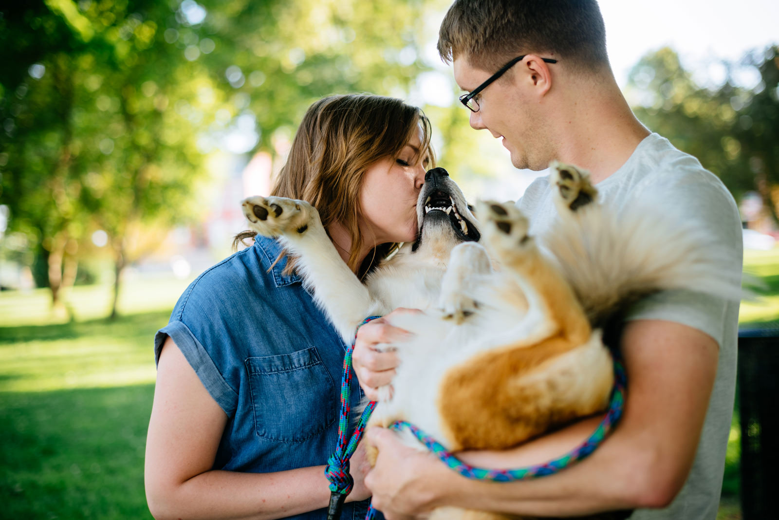 loving on a dog during engagement session